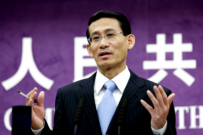 Ministry of Commerce spokesman Shen Danyang answers questions on Oct. 9 at a news conference in Beijing. Shen said that if the EU continued to adopt restrictive trade measures, the bloc's long-term economic interests would be adversely affected. Photo: Li Huisi/CNS photo