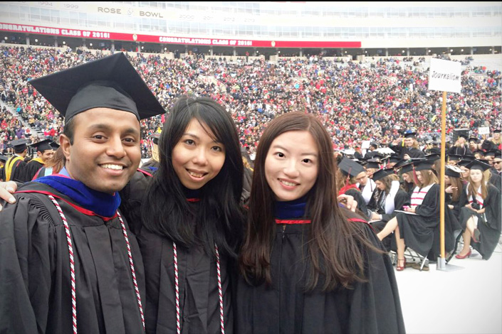 Wu Qihui (right) poses with classmates in May 2016 at the University of Wisconsin-Madison commencement in Madison, Wisconsin. Photo provided by Wu Qihui