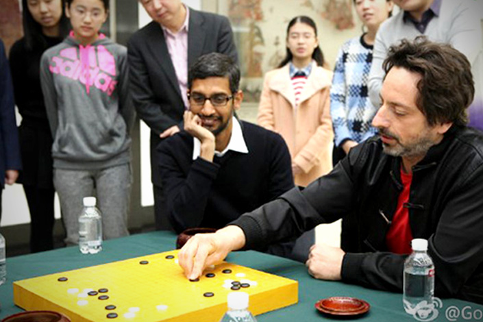 Google CEO Sundar Pichai (left) and Google co-founder Sergey Brin visit a Go training school in Beijing on Tuesday. Brin is playing a game of Go with renowned former champion Nie Weiping (not shown). Photo provided by Google