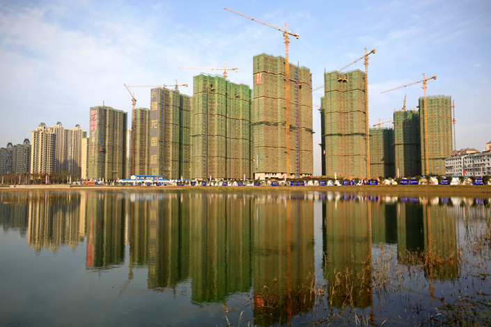 Commercial buildings under construction are visible in Xiangyang, Hubei province, on Nov. 30. Photo: IC