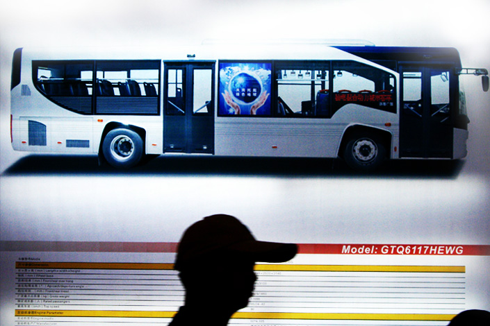An advertisement showing Granton's bus model is exhibited at the Beijing Exhibition Center during the 5th China International Exhibition of Electric Vehicles, New Energy Vehicles and Leisure Sports Vehicles on July 15, 2009. Photo: Visual China