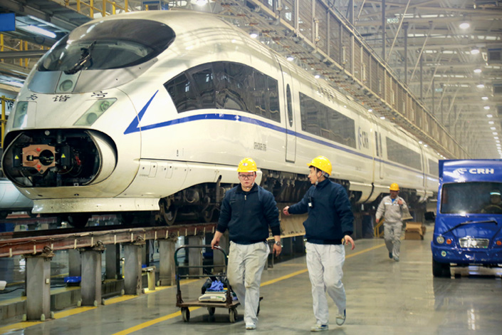 Engineers work on a bullet train in a railway maintenance and repair factory at the Xi'an Railway Administration on Tuesday. Photo: IC