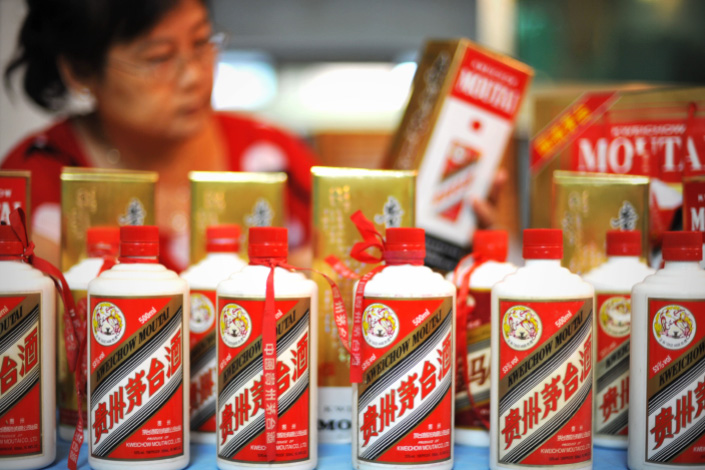 Bottles of Moutai, a famous distilled Chinese liquor produced by Kweichow Moutai Co. Ltd, are displayed in a store in Qionghai, Hainan province, in August 2013.  As one of the most popular spirits at state banquets, Moutai has branded itself as the
