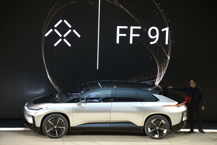 Head designer of car manufacturer Faraday Future, Richard Kim, presents the first production model of the FF91 electric car, at the Consumer Technology Show in Las Vegas on Tuesday. Photo: IC