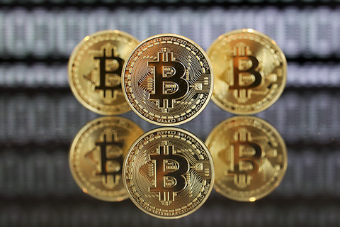 Regulators order halt to virtual currency trading platforms after ban on initial coin offerings. Photo: Visual China.