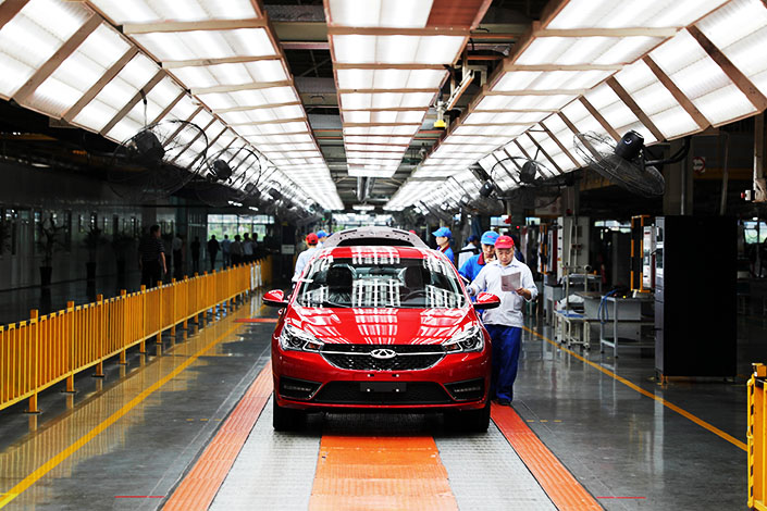 Chery Automobile Co. Ltd. employees work on an assembly line inside the manufacturing plant in Anhui province in October. Chinese automakers sold 28.1 million cars in 2016, up 14.5% from 2015. Photo: Visual China