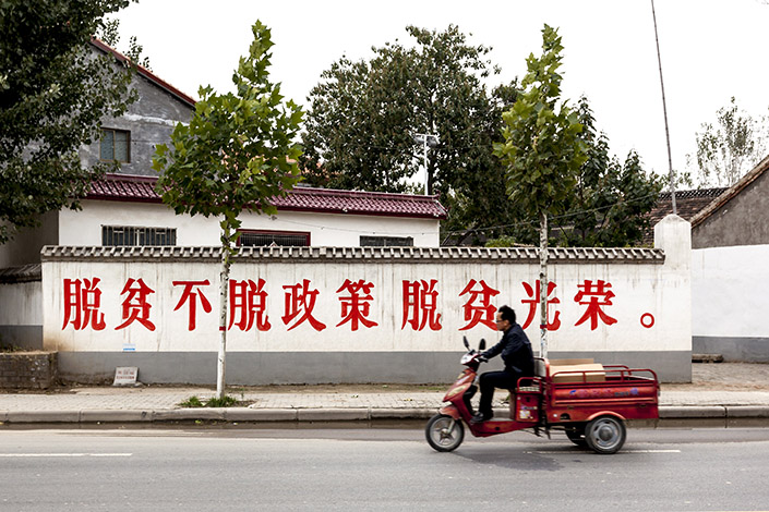 A sign in Lankao county, Henan province, in October says people should be proud to be lifted out of poverty. The Lankao government vowed to get about 80,000 people out of poverty by 2016. Photo: Visual China