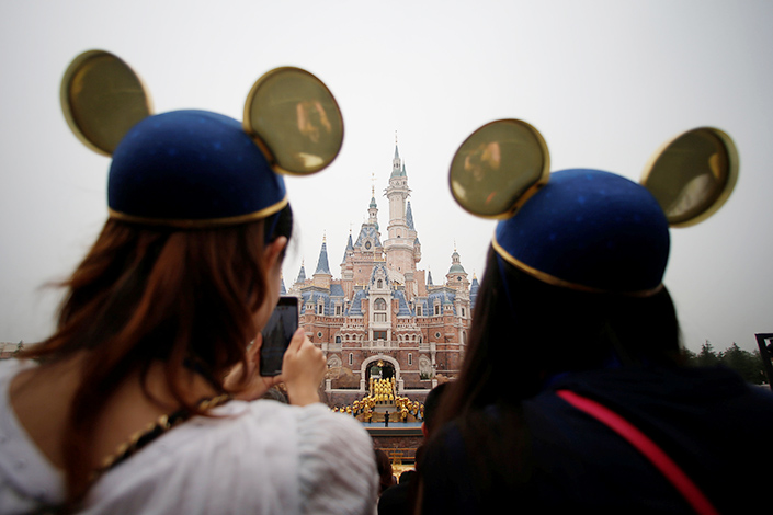 Shanghai Disney Resort customers watch the complex's opening ceremony on June 16. About 5.6 million people visited the resort as of the end of 2016, making Shanghai's Disney complex the fastest to reach 5 million customers. Photo: Visual China