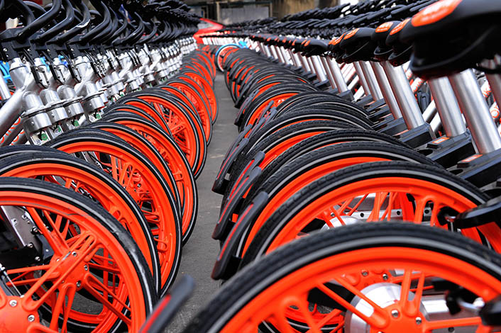 Mobikes confiscated for breaking city sanitation rules sit in a street office in Chengdu, Sichuan province, on Nov. 26, 2016. The Chinese government is expected to soon unveil new regulations on the country's fledgling bike sharing industry.  Photo: Visual China