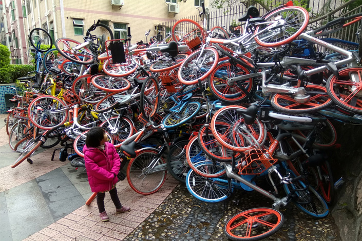 A pile of bicycles from bicycle-sharing companies sits in a park in Shenzhen, Guangdong province, on Jan. 16. Improper parking and malicious sabotage have become headaches for  local authorities and the bike-sharing companies that have made more than 300,000 vehicles available for rental in the city. Photo: Visual China