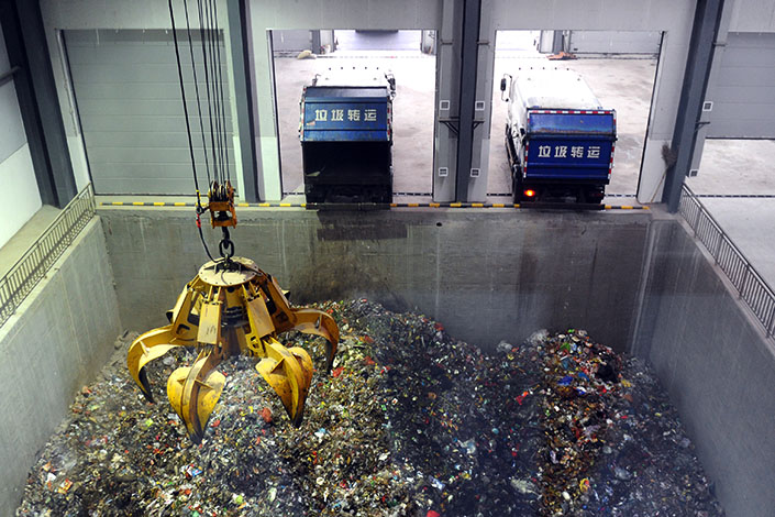 Modern waste-treatment equipment sorts trash in a disposal factory in Xinmi, Henan province, in October 2013. The National Development and Reform Commission is requiring the nation's municipalities and provincial capitals to have garbage-sorting systems by the end of 2020. Photo: Visual China