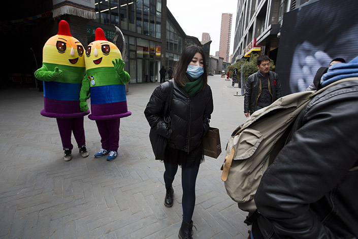 Condom mascots make an appearance at a Beijing event in November 2014, ahead of World AIDS Day, to promote awareness of HIV testing. The Chinese government has vowed to further reduce the HIV infection rate among various groups by 2020. Photo: IC
