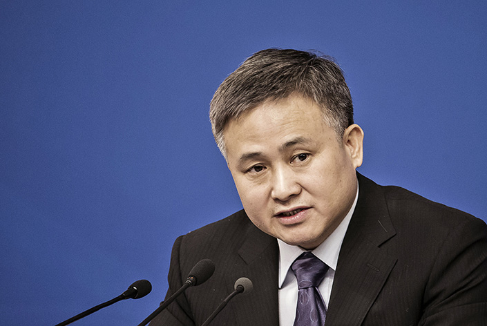 Pan Gongsheng, deputy governor of the People's Bank of China and administrator of the State Administration of Foreign Exchange, speaks during a news conference of the 12th National People's Congress (NPC) in Beijing on March 12, 2016. Pan said Sunday that authorities will crack down on violations like moving assets overseas through fake overseas investments. Photo: Visual China