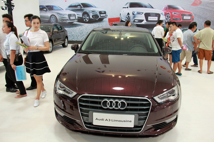 Visitors at an automobile exhibition check out an Audi A3 limousinein Haikou, Hainan province, in July 2015. The German luxury-auto brand is the latest carmaker to show plunging China sales in January. Photo: IC