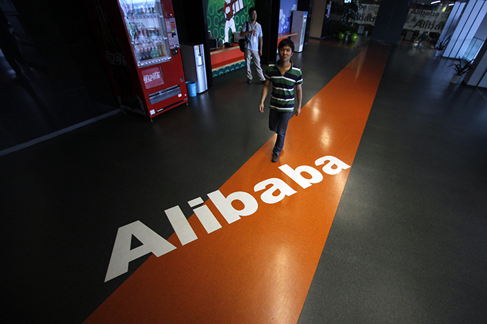 Alibaba Group Holding Ltd. said Monday that it was forming a strategic partnership with department store operator Bailian Group. Meanwhile, Sun Art Retail Group Ltd. denied earlier media reports that the owner of China's leading supermarket chain was in its own talks with Alibaba. Photo: Visual China