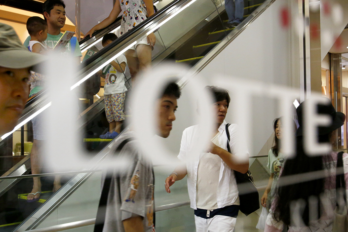 China's official Xinhua News Agency has warned in an editorial that retailing giant Lotte could face