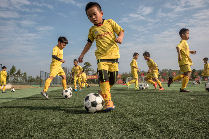 Boys practice soccer at the Evergrande Football School in Qingyuan, Guangdong province, on Dec. 6. China's Ministry of Education plans to develop 50,000 schools specializing in soccer training by 2025. Photo: IC