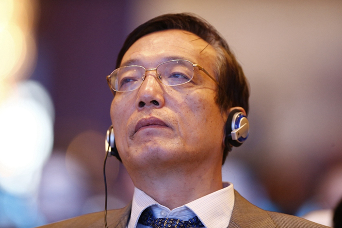 """Liu Shijin, the former vice director of State Council Development Research Institute, said on Saturday that China's economy """"is very close to"""" or """"has started"""" bottoming out after nearly seven years of growth deceleration. Photo: Caixin"""