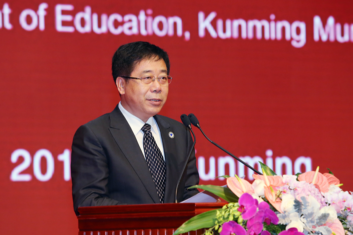 """Chinese Education Minister Chen Baosheng speaks at the 11th Confucius Institute Conference in Kunming, Yunnan province, on Dec. 10. Chen has told affluent universities on China's east coast to """"show mercy"""" when poaching talent from schools in the poorer central and western parts of the country. Photo: Visual China"""