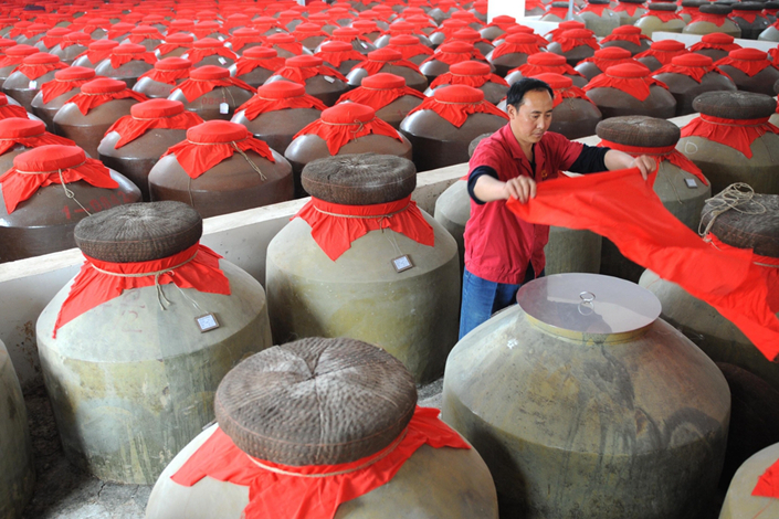 A worker seals liquor tanks in Mianzhu, Sichuan province, in May 2009. Photo: Xinhua