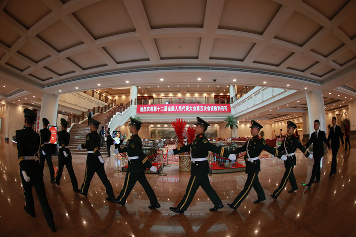 Soldiers from Beijing's armed police who are responsible for security at the meetings of the National People's Congress and Chinese People's Political Consultative Conference arrive at the Guoerzhao Hotel in Beijing on Tuesday. Photo: IC
