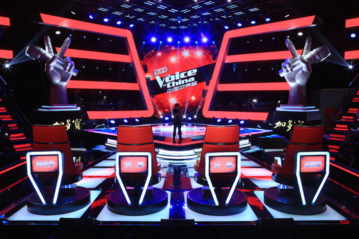 A technician prepares for a filming session of the fourth season of Chinese reality talent TV show 'The Voice of China' in Jiaxing city, Zhejiang province, June 16, 2015. Photo: IC