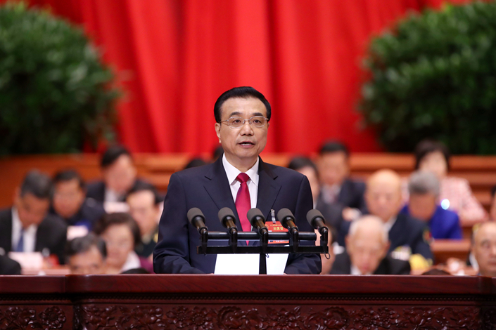 Premier Li Keqiang delivers the government work report at the Great Hall of the People in Beijing on Sunday during the opening of the fifth session of the 12th National People's Congress. Li's report did not include mention of proposed reform to the nation's IPO system. Photo: CNS