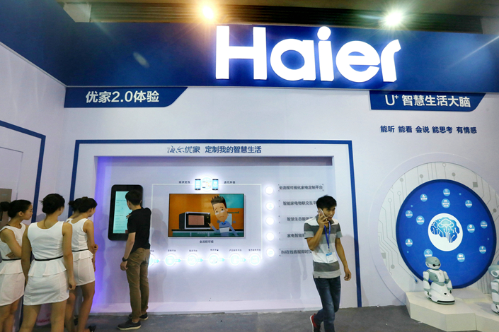 "People visit the Haier display during an exhibition in Beijing in August. The appliance giant plans to open 300 ""experience stores"" in China to promote its ""smart"" home equipment. Photo: IC"