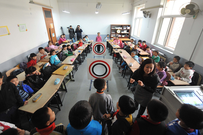 Primary-school students participate in a sex-education class in Beijing in December 2010. A sex-education book used by second-graders in a school in Hangzhou has been recalled by officials after a mother complained that the material was too explicit for children that age. Photo: Visual China