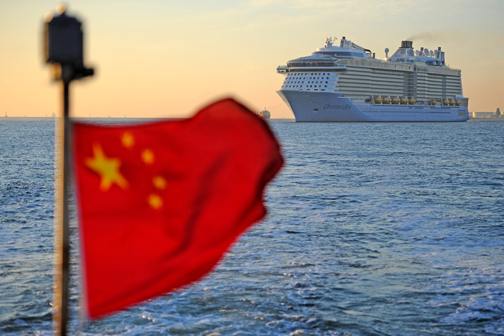 The Royal Caribbean Cruises Ltd. ship Ovation of Seas arrives at the Tianjin International Cruise Home Port on June 24. Royal Caribbean has removed all China-originating trips to South Korea from its website, citing unspecified