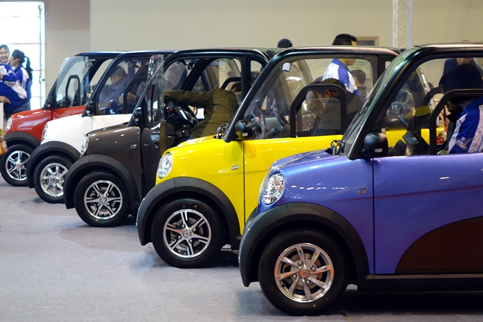 Quadricycles are displayed at the Green Auto China show in Zhengzhou, Henan province, on March 10, 2015. Thirty-two Chongqing delegates to the National People's Congress have suggested classifying the vehicles as motorcycles, which would legalize them and end the uncertainty surrounding their status. Photo: Visual China