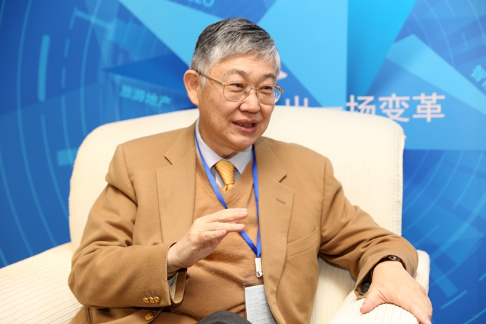 Shih Wing-ching, the founder of Hong Kong property developer Centaline Property Agency Ltd., says that his mainland competitors have the motivation and willingness to take risks that present a competitive challenge to established Hong Kong developers. Photo: IC