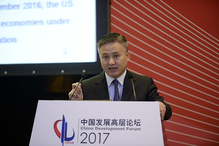 Pan Gongsheng,director of the State Administration of Foreign Exchange, speaks during a China Development Forum event in Beijing on Monday. Pan said the surge in outbound direct investment in 2016