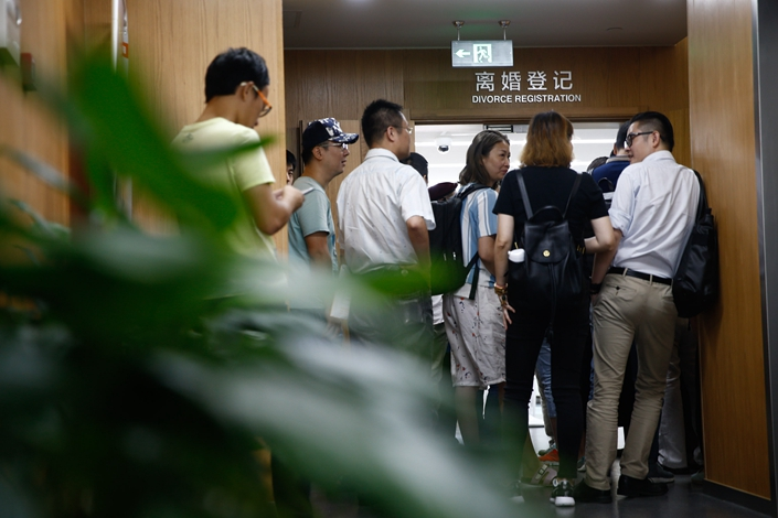 People visit their local civil affairs bureau to register for divorce, on Aug. 30, 2016. Starting Friday, couples who already own a house in Beijing and have been divorced for less than a year will be regarded as second-time home buyers. Photo: Visual China