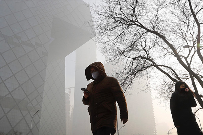 Heavy smog blankets Beijing on Jan. 3. The growing popularity of air purifiers to combat pollution has led the government to work on establishing standards for air filters.