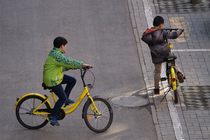 Children ride Ofo shared bicycles in Tianjin. A traffic accident that killed an 11-year-old using a shared bike has sparked heated debate online. Photo: IC
