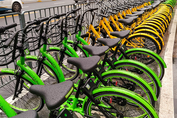 Two-wheelers of several bike-sharing companies crowd a street in Shenzhen, Guangdong province, on March 19. Youon Bikes, a newcomer to the booming nascent industry, is the first Chinese bike-sharing company to seek permission for an initial public offering. Photo: Visual China