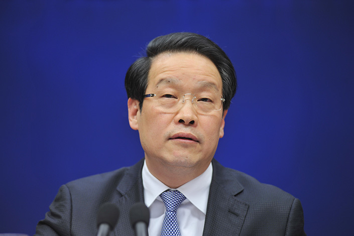Xiang Junbo, Chairman of China Insurance Regulatory Commission, speaks at a press conference in Beijing on Feb.22. Photo: IC