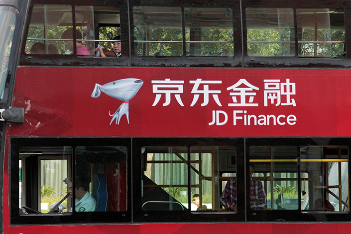 The logo of JD Finance, the finance arm of e-commerce company JD.com, is seen on a bus in Beijing, China, on Sept.18, 2015. JD.com has added an innovative layer to one of its mobile apps through which third-party financial institutions can build and operate investment product sales platforms. Photo:IC