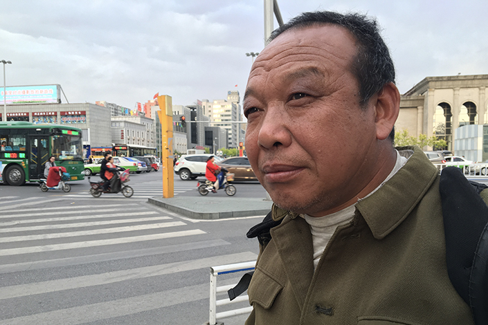 Feng Jun has been fighting a nine-year legal battle against two steel companies that allegedly dumped thousands of tons of toxic waste into the Baoqiu River in northern Hebei province. Photo: Caixin