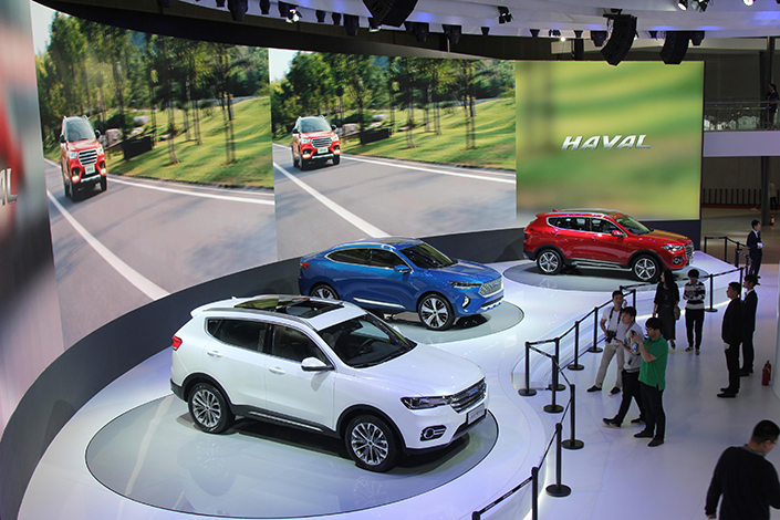 Visitors look at cars on show at the 17th Shanghai International Automobile Industry Exhibition in Shanghai, China, on April 20, 2017. Photo: IC