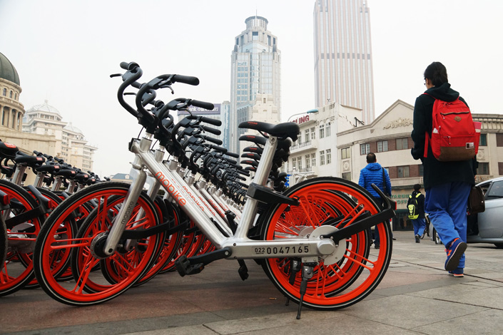 The northern port city of Tianjin has become the eighth Chinese city to roll out draft rules on shared bicycles. Above, shared bikes of leading operator Mobike line Tianjin's streets. Photo: IC
