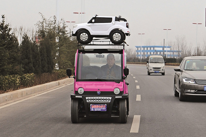 Chinese regulators are still trying to decide how to legally classify quadricycles, putting the huge industry's future in doubt. The small electric vehicles, such as the one above in Shanxi province, have become popular in rural China as a cheap alternative to automobiles. Photo: Visual China