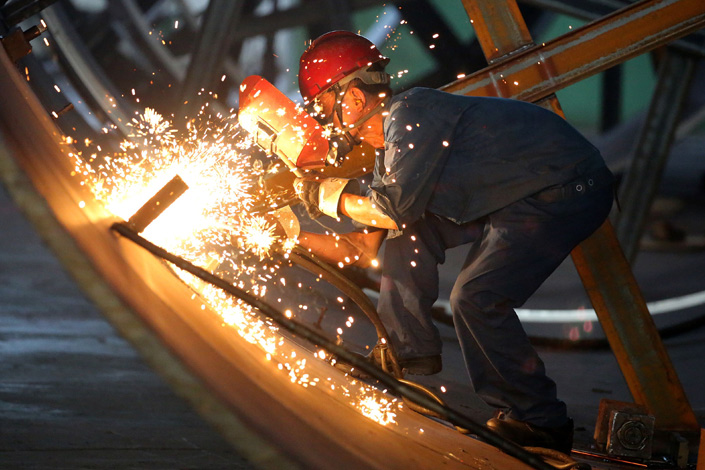 Ning Jizhe, vice chairman of the National Development and Reform Commission, said earlier this month he believes China's economy will continue to be better off as positive factors will keep supporting growth. Above, a worker welds steel at a Pengfei Group plant in Haian, Jiangsu province, on Aug. 23. Photo: IC