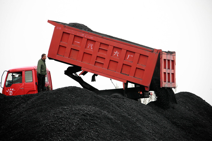 China's industrial companies saw their combined earnings growth slow in March from the first two months of the year. Above, a truck unloads coal at a coking company in Huaibei, Anhui province, on March 29, 2013. Photo: Visual China