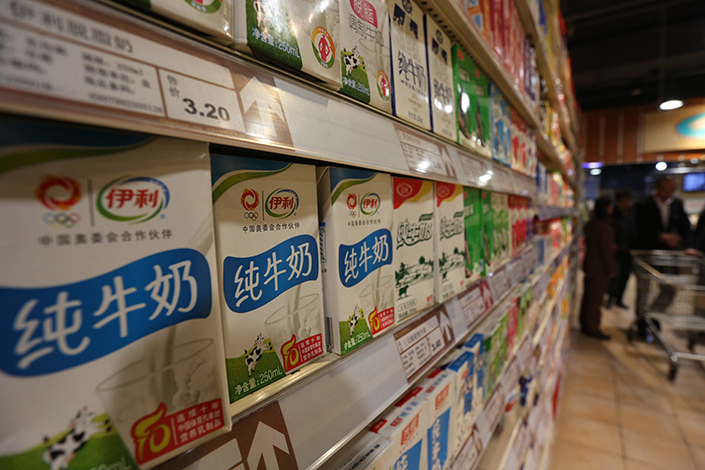 Inner Mongolia Yili Industrial Group Co. Ltd. has given up its plans to buy a controlling stake in rival Inner Mongolia Yili Industrial Group Co. Ltd. Above, Yili milk sits in supermarket shelves in Xuchang, Henan province, in November 2014. Photo: Visual China