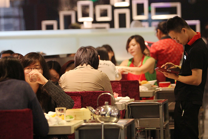 Top Hot Pot Chain Tests Waters With Sister Company's Listing