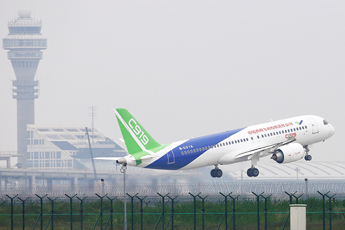 The C919 passenger jet, made by Commercial Aircraft Corp. of China, takes off from Shanghai Pudong International Airport during its maiden flight on Friday.  Photo: Visual China