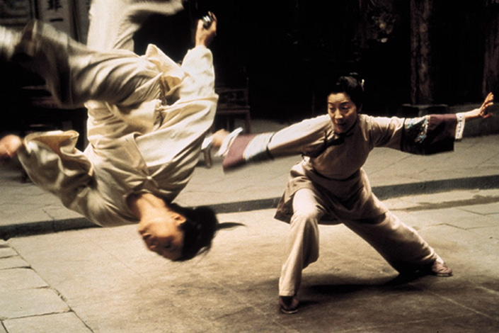 A poster shows a fight scene from the movie Crouching Tiger, Hidden Dragon for which Tan Dun wrote the soundtrack. Photo: IC