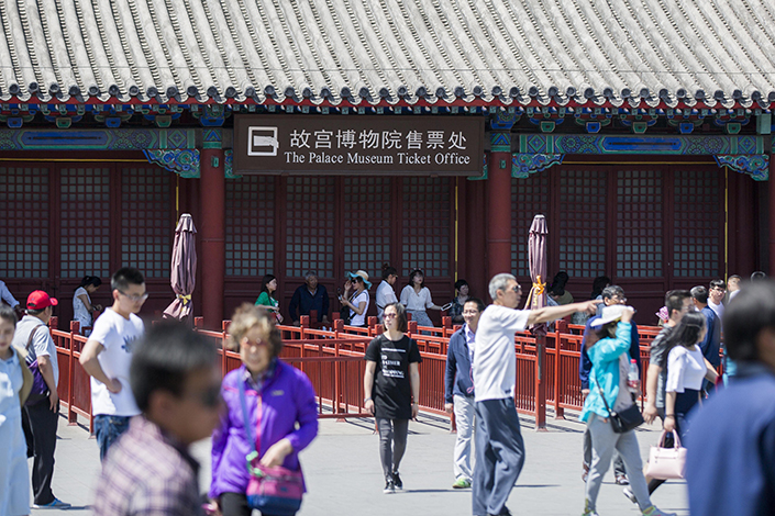The Forbidden City, one of China's top tourist attractions, will have tickets available only online from July through October under a pilot program. Ticket-purchase assistance will be available on-site for visitors who aren't tech-savvy. Photo: Visual China